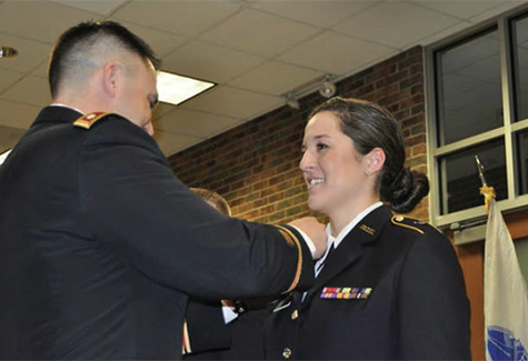 Lt. Col. James Bunyak pins the nursing corps insignia on Cadet Olivia Wood